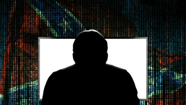 silhouette of a person at a computer